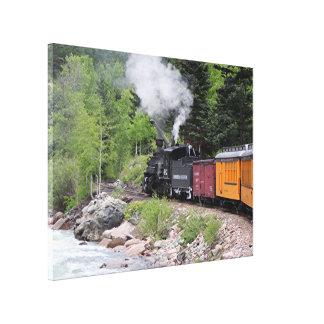 Steam train & river, Colorado, USA Canvas Print