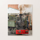 """STEAM TRAINS JIGSAW PUZZLE<br><div class=""""desc"""">Wales, the land of the little steam trains. These little Welsh steam trains were mainly used originally for hauling slate from the quarries..These beautiful little green steam trains from the Talyllyn Railway, with steam and smoke billowing, are a fine example of British historical engineering, all brought to life with Zazzle&#39;s...</div>"""