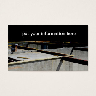 steel beams by a concrete foundation business card