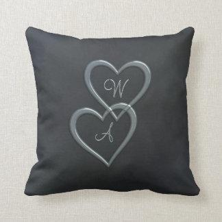 Steel blue hearts on grey pillow