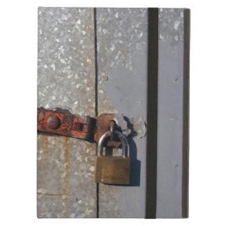 Steel doors locked with a rusty padlock iPad air case