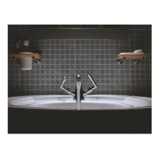 Steel faucet running in washbasin postcard