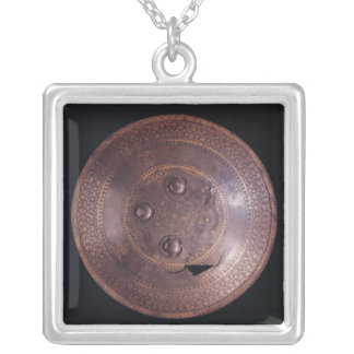 Steel shield with intricate gold decoration pendants