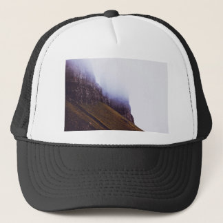 steep mossy cliffs shrouded in mist trucker hat