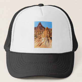 Steep weathered slopes of orange mountains.JPG Trucker Hat