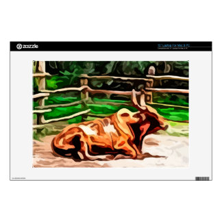Steer bull laying down near fence painting decals for laptops