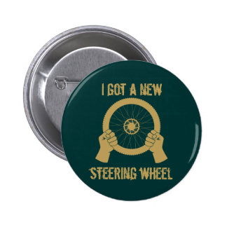 Steering wheel pinback button