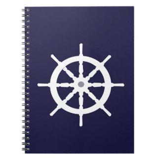 Steering wheel on navy blue background. notebook