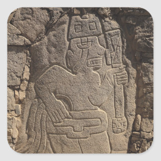 Stela depicting a warrior holding a club square sticker