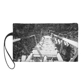 Steps down a wooden watch tower wristlet clutches