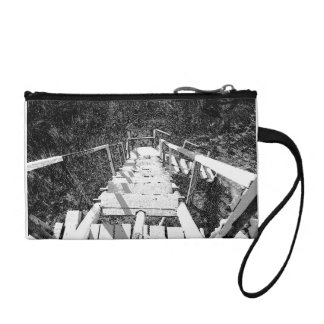 Steps down a wooden watch tower change purses