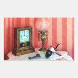 Stereopticon, lámpara y reloj etiqueta