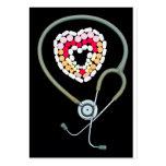 Stethoscope surrounding pills business card