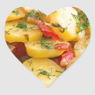 Stew of potatoes with onion, bell pepper and dill heart sticker