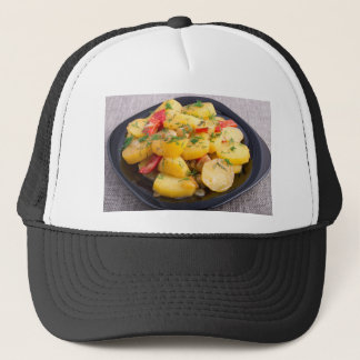 Stew of potatoes with onion, bell pepper and dill trucker hat