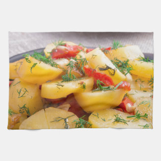 Stew of potatoes with onion, bell pepper, fennel kitchen towel