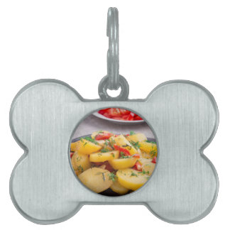 Stew of potatoes with onion, bell pepper, fennel pet name tag