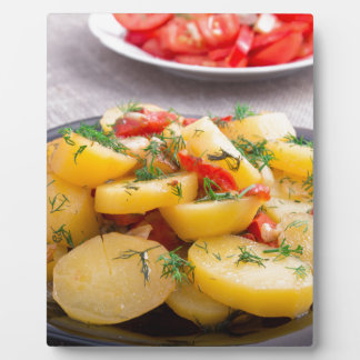 Stew of potatoes with onion, bell pepper, fennel plaque