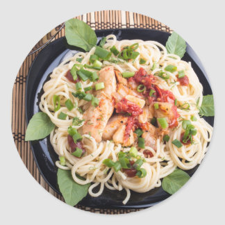 Stewed chicken with tomato sauce on a plate classic round sticker