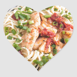Stewed chicken with tomato sauce on a plate heart sticker