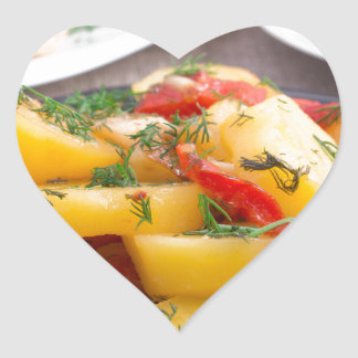 Stewed potatoes with bell pepper closeup heart sticker