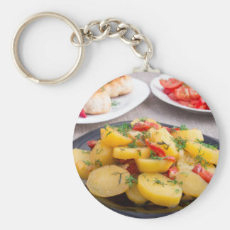 Stewed potatoes with bell pepper closeup keychain