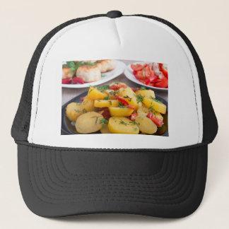 Stewed potatoes with bell pepper closeup trucker hat