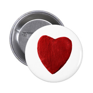 Stick button on with red heart