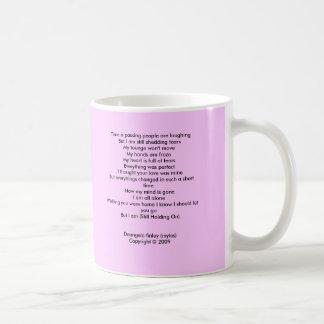 Still holding on mug