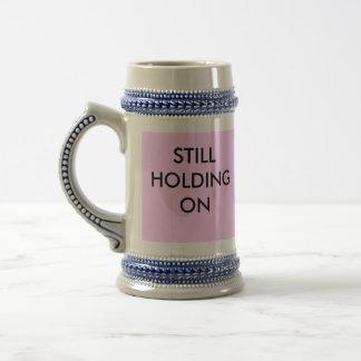Still holding on tall mug