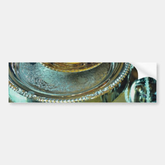 Still life, gold teacup and silver plates car bumper sticker