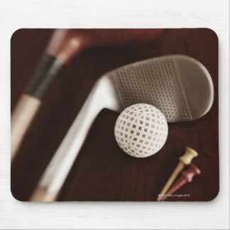 Still life if vintage golf clubs tees and ball mouse pad