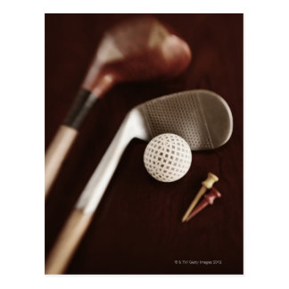 Still life if vintage golf clubs, tees and ball. postcard