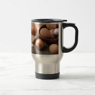 Still life in dark light on background of textile travel mug