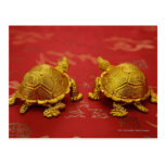 Still life of a pair of gold tortoise figurines postcards