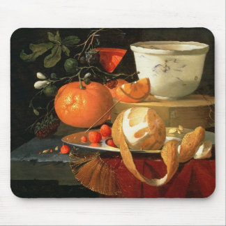 Still life of an orange mouse pad