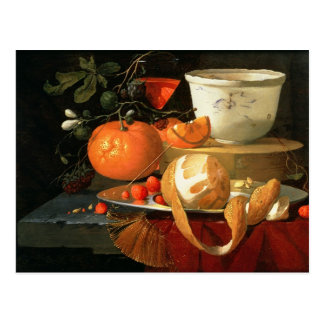 Still life of an orange postcard