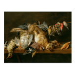 Still life of dead birds and a hare on a table postcard