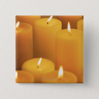 Still life of lighted candles button