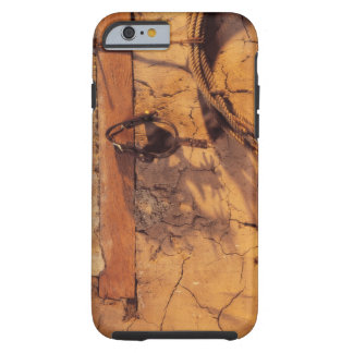 Still life of spurs and lasso hanging on adobe iPhone 6 case