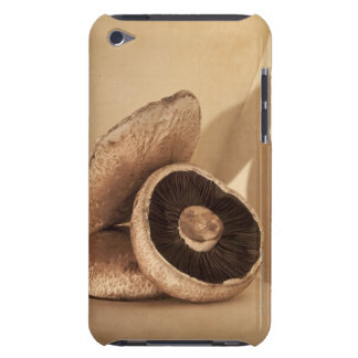 Still life with flat mushrooms and dramatic barely there iPod case