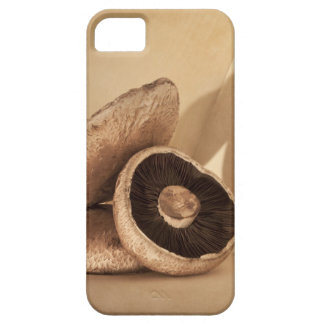 Still life with flat mushrooms and dramatic iPhone SE/5/5s case