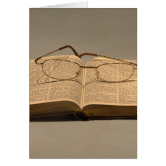 Still life with open bible and reading glasses card