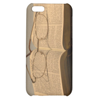 Still life with open bible and reading glasses case for iPhone 5C