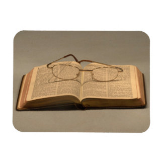 Still life with open bible and reading glasses magnet