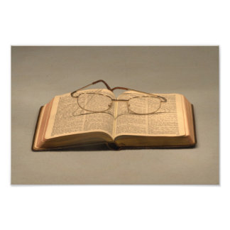 Still life with open bible and reading glasses photo print