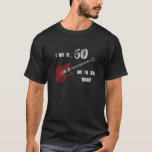 """Still Rockin&#39; at 60, red &amp; black guitar shirt<br><div class=""""desc"""">60th birthday with a red and black guitar featured on this cool birthday shirt. Guitar designed and produced by my son Brady who has a zazzle store called spiritswitchboard.</div>"""