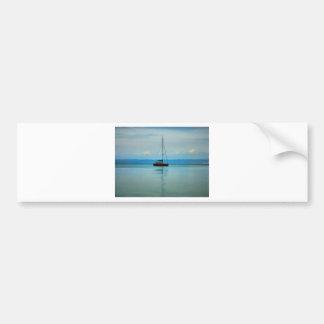 Still water with yacht bumper sticker