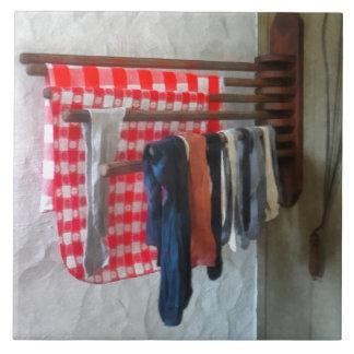 Stockings Hanging to Dry Tiles