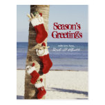 Stockings on palm tree at beach postcard